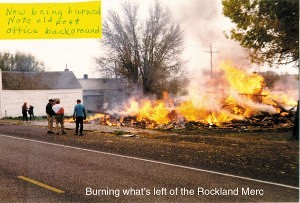 Remains of the Rockland Mercantile being burned. Note the old post office in the background.